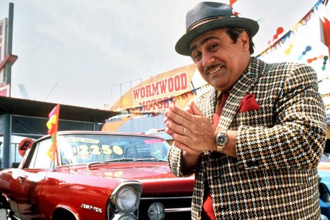 Image of Wormwood, the father and slick car salesman from Matilda